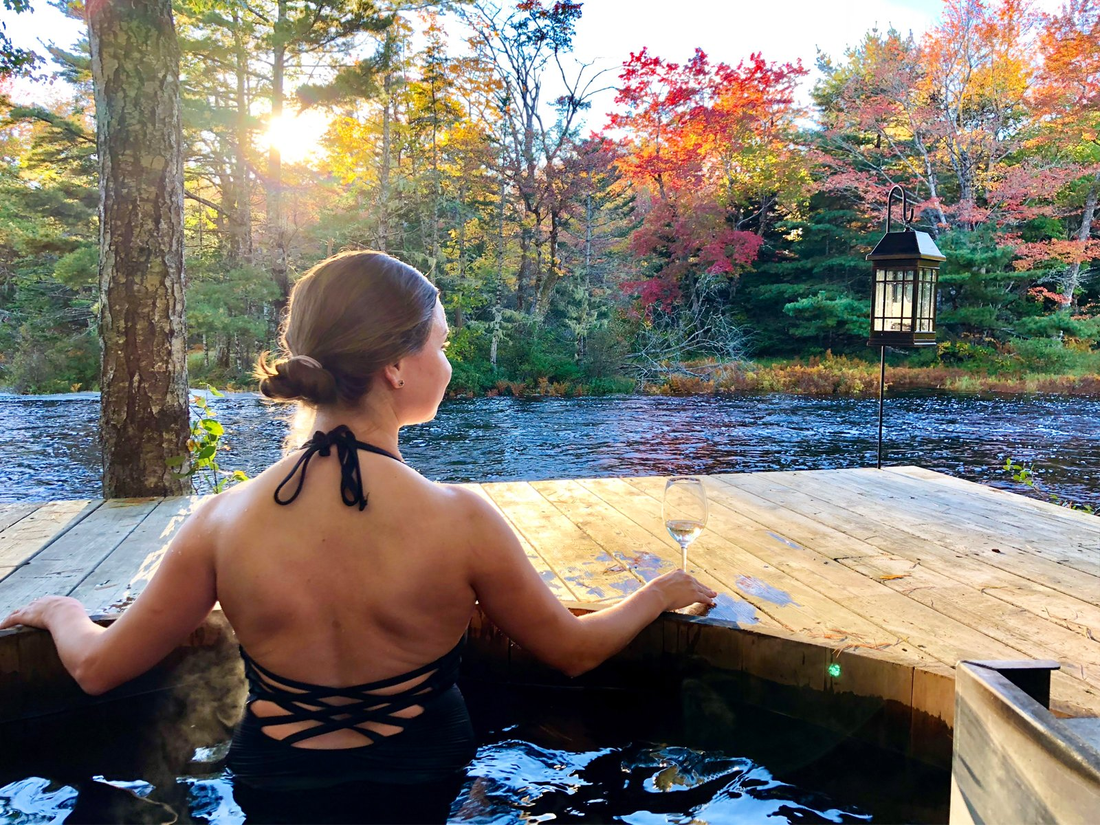a woman enjoying the hot tub at Trout Point Lodge in Nova Scotia