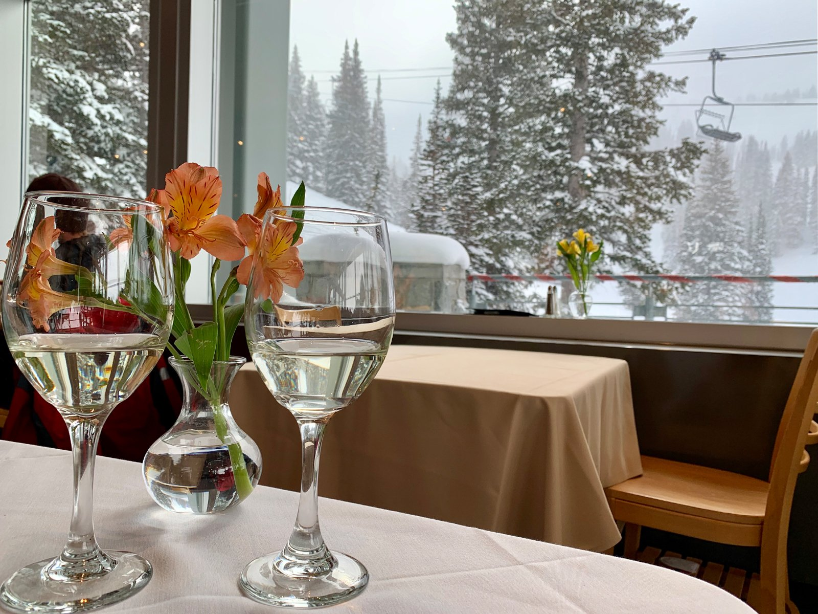 wine glasses on a table at collins grill at alta ski resort