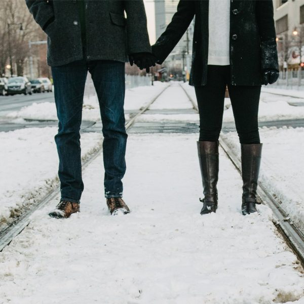 couple holding hands in boston