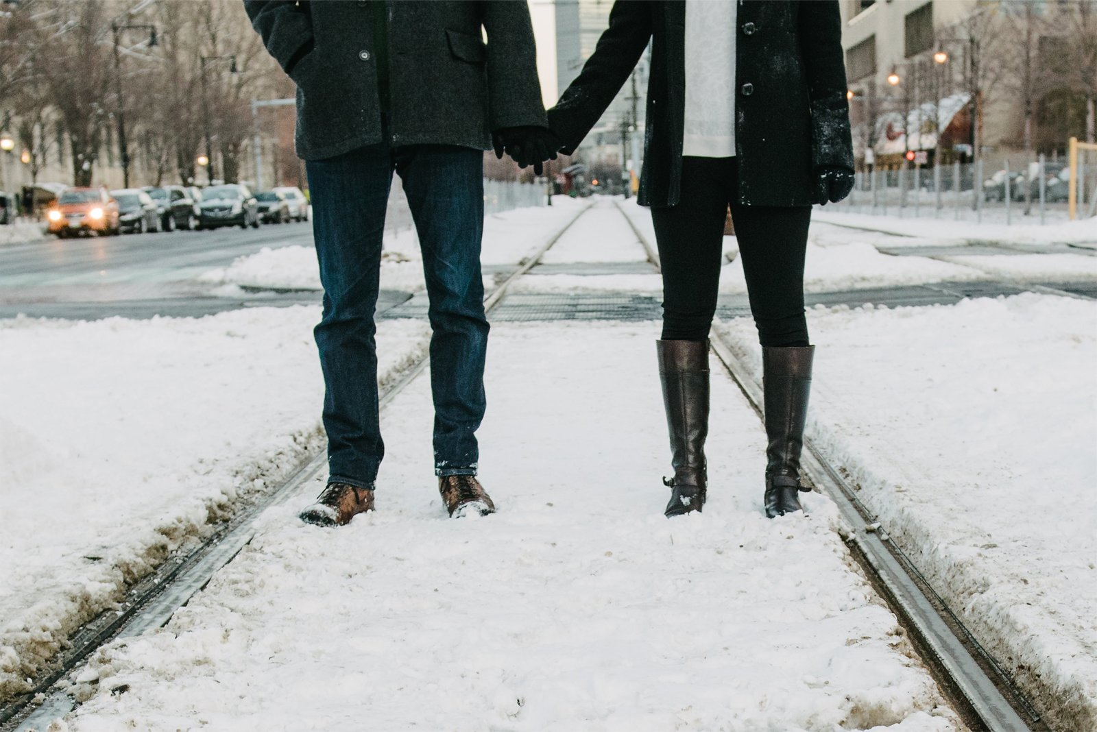 a couple holding hands on a date in Boston, Massachusetts