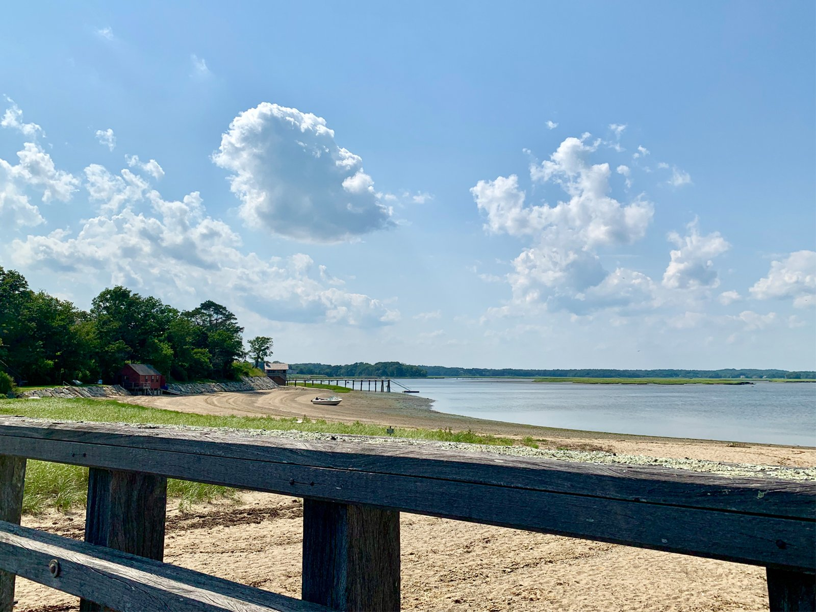 view of the beach from Powder Point Bridge in the summer in Duxbury, MA