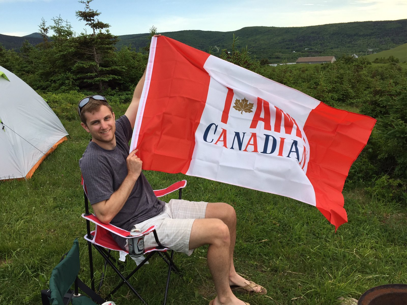 man waving a Canadian Flag in Nova Scotia