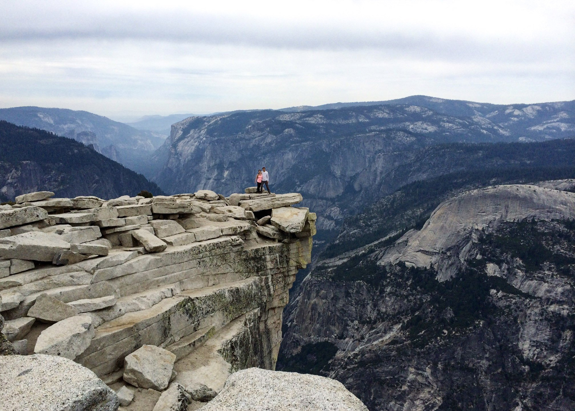 a couple hiking Half Dome in Yosemite National Park, California