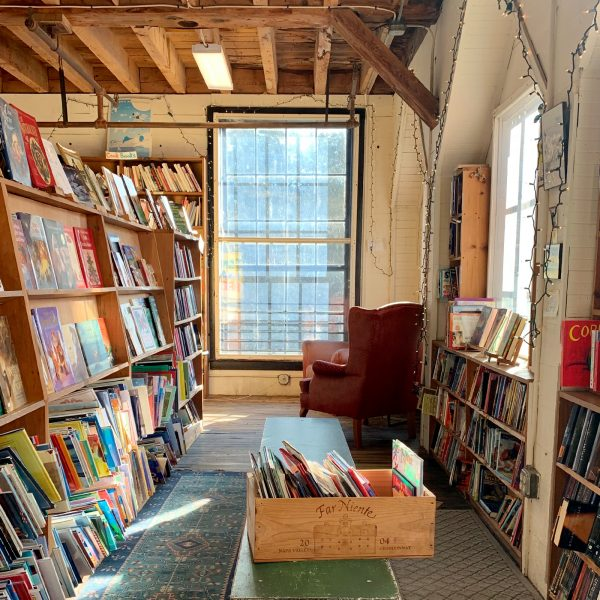 an aisle filled with books at the Montague Bookmill in Montague, MA