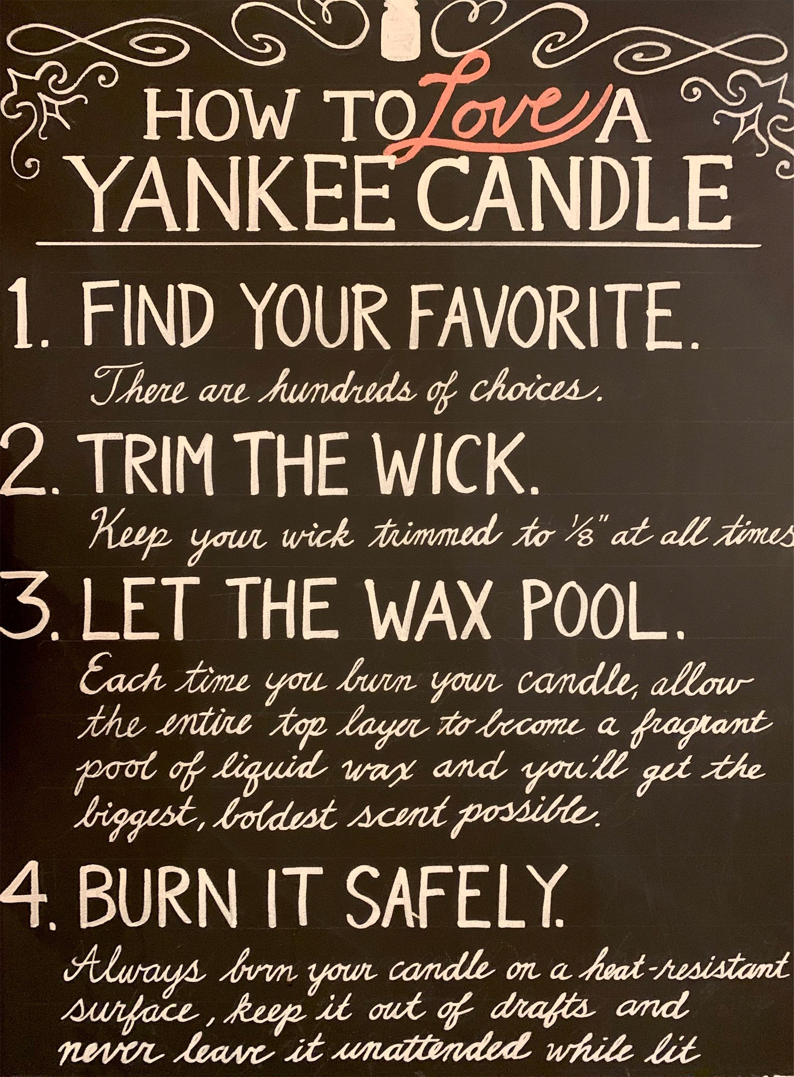 a chalkboard sign describing how to love a yankee candle on display at the yankee candle village in south deerfield, massachusetts