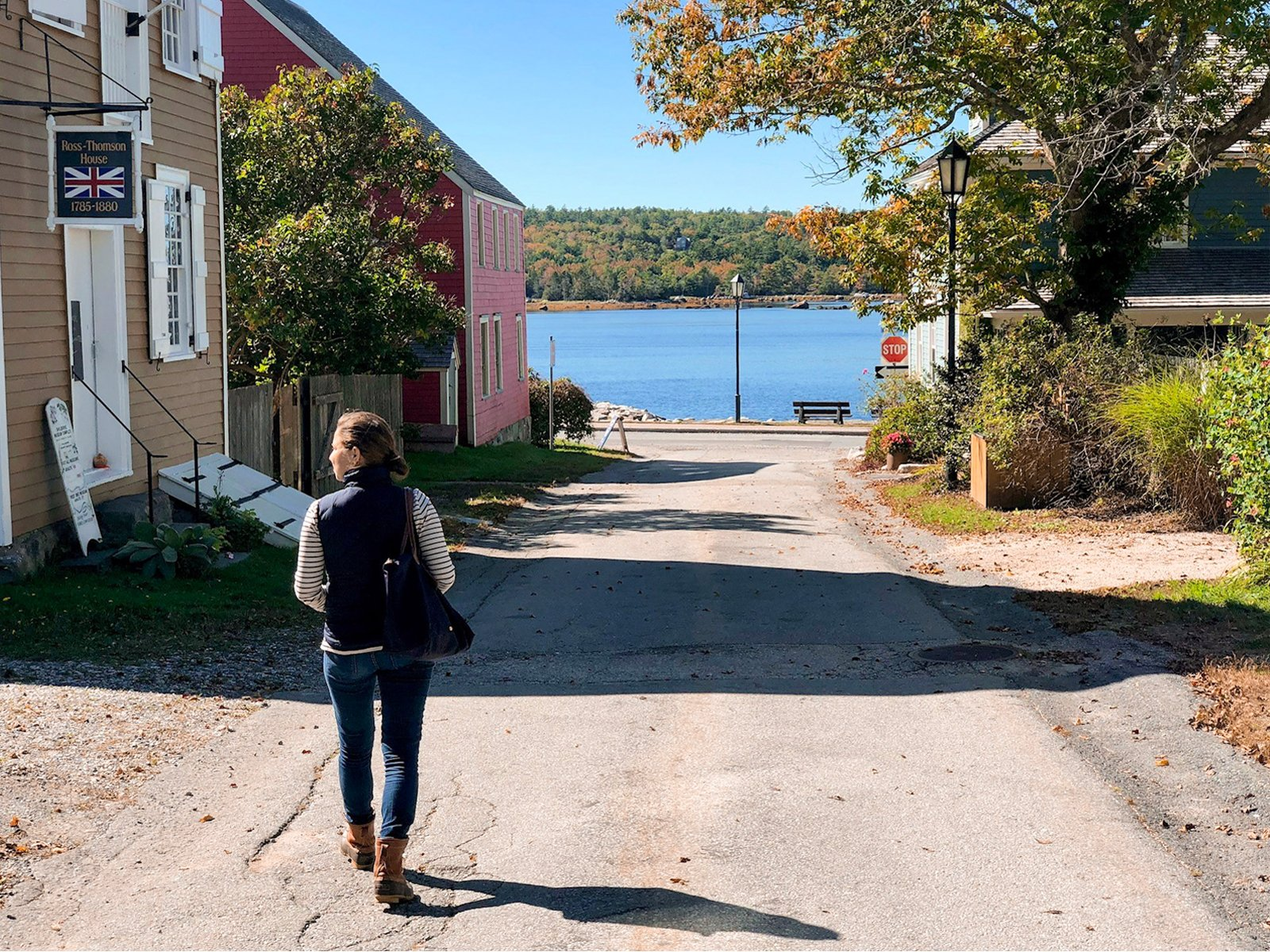 a woman walking down a road in Shelburne, Nova Scotia