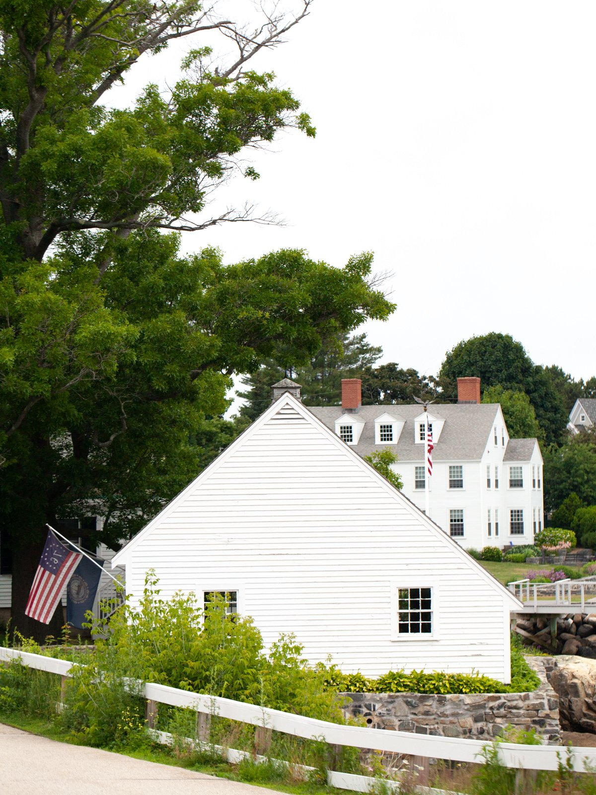 a white house with a flag in New Castle, NH