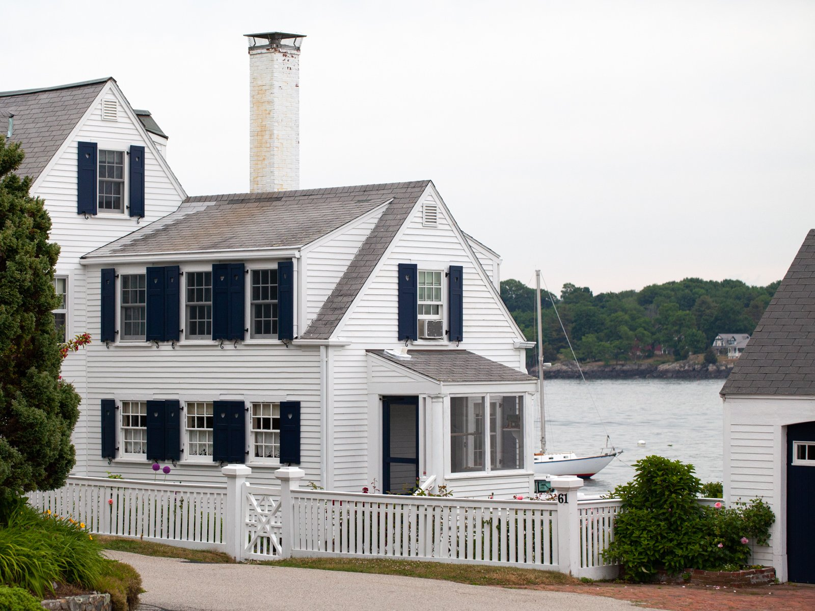 a coastal home with a white picket fence in New Castle, NH