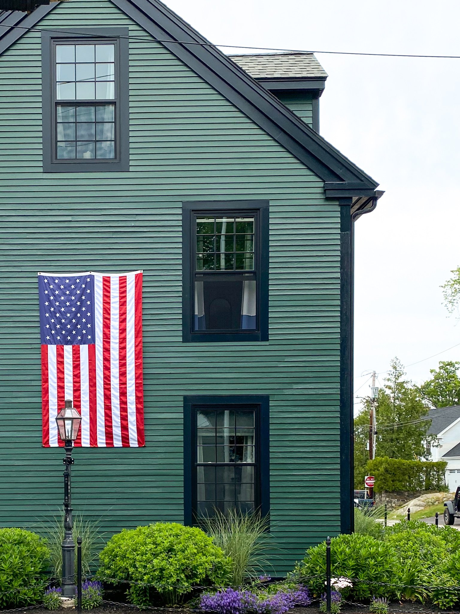Great Island Inn with an American flag in New Castle, NH